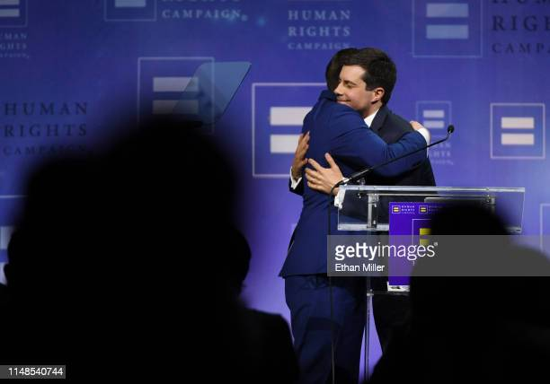 Chasten Glezman Buttigieg hugs his husband, South Bend, Indiana Mayor Pete Buttigieg, after he delivered a keynote address at the Human Rights...
