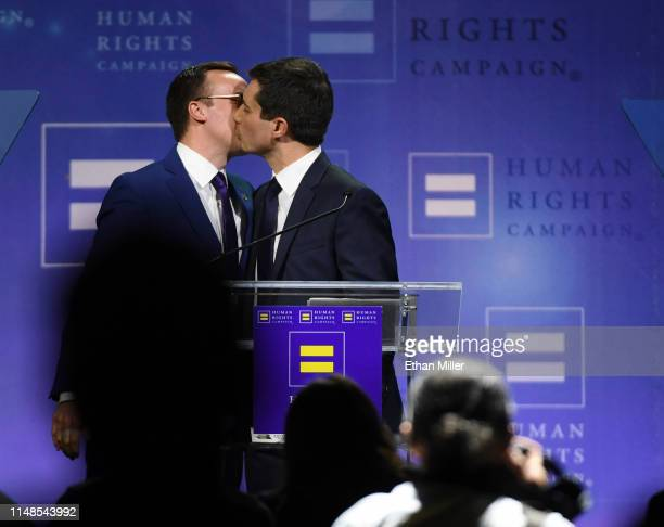 Chasten Glezman Buttigieg kisses his husband, South Bend, Indiana Mayor Pete Buttigieg, after he delivered a keynote address at the Human Rights...