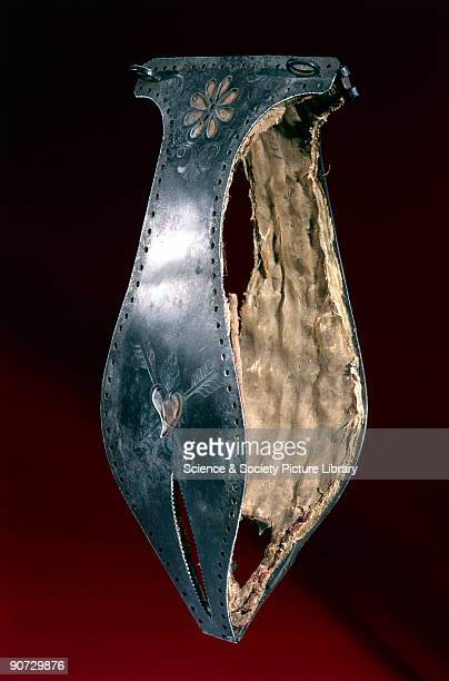 Chastity belt decorated with a flower design and a heart pierced with arrows Chastity belts originated in the 15th century They were devices designed...