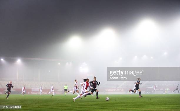 Chastity Grant of AFC Ajax is challenged by Simone Laudehr of FC Bayern Muenchen during the UEFA Women's Champions League round of 32 second leg...