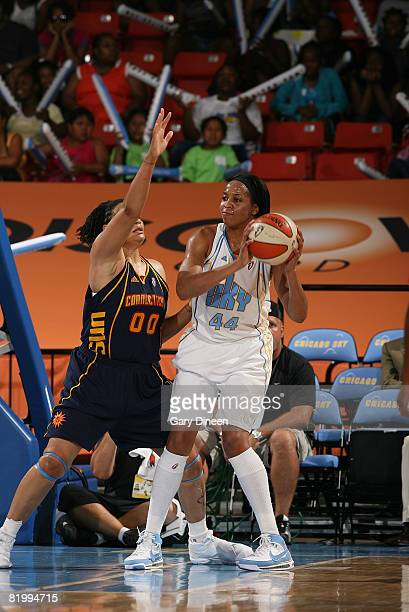 Chastity Melvin of the Chicago Sky looks to pass while guarded by Tamika Whitmore of the Connecticut Sun during the WNBA game on July 18 2008 at the...