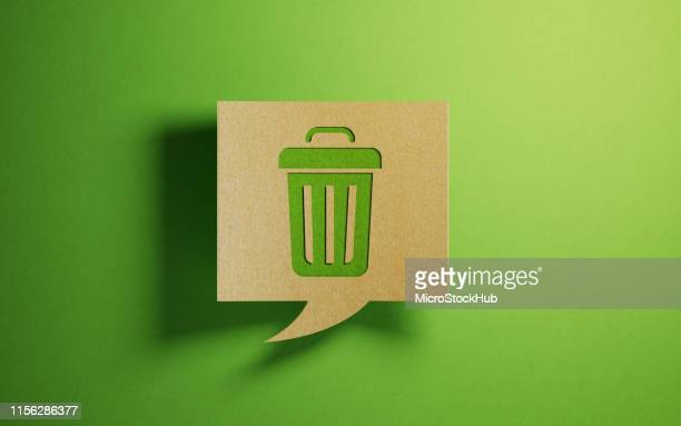 chat bubble made of recycled paper on green background - garbage bin stock pictures, royalty-free photos & images