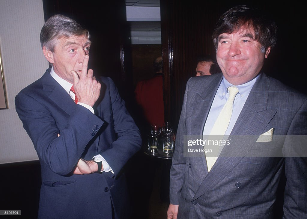 Chat show host Michael Parkinson (left) and comedian Jimmy Tarbuck attend a Variety Club Luncheon at the Hilton Hotel in London, 15th December 1988.
