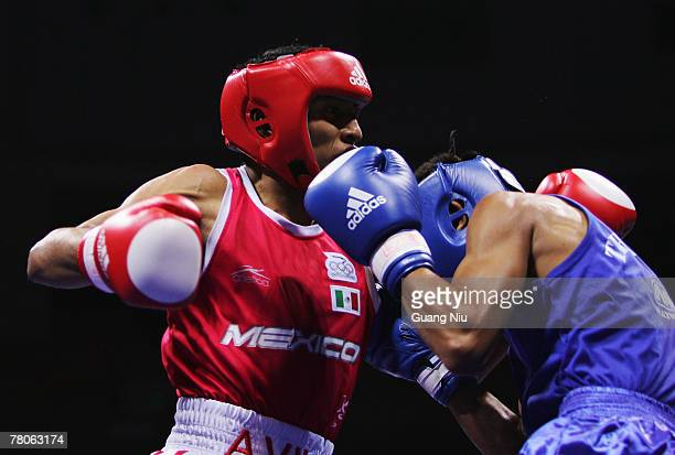 Chatchai Butdee of Thailand fights against Braulio Avila of Mexico during the Men's Fly Weight finals at the 'Good Luck Beijing' International Boxing...