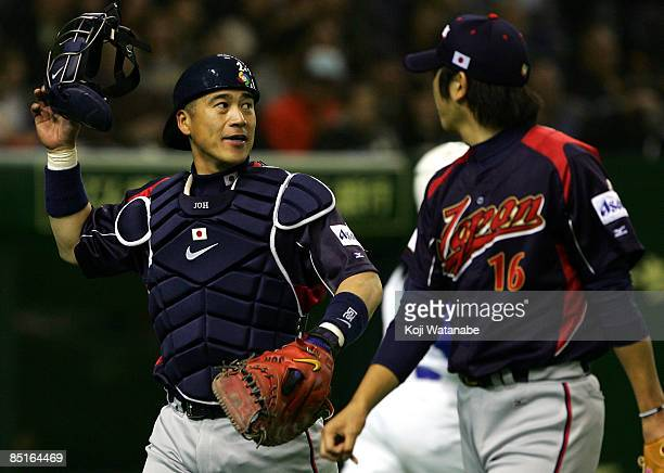Chatcher Kenji Johjima of Japan looks on during a friendly match between Japan and Yomiuri Giants at Tokyo Dome on March 1, 2009 in Tokyo, Japan.