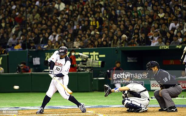Chatcher Shinnosuke Abe of Japan bats during a friendly match between Japan and Saitama Seibu Lions at Tokyo Dome on February 28 2009 in Tokyo Japan