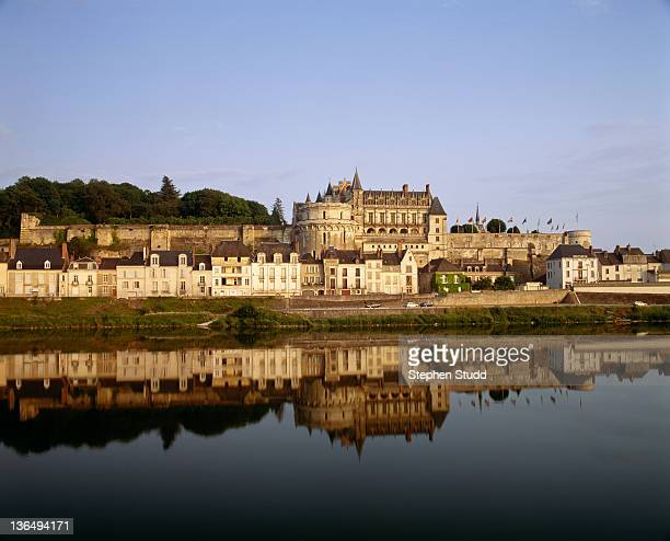 Chateau d`Amboise reflected in river Loire