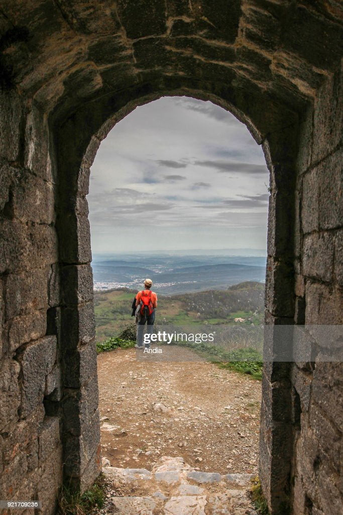 Chateau de Montsegur, castle, former Cathar fortress in the south of France: tourist looking at the view.