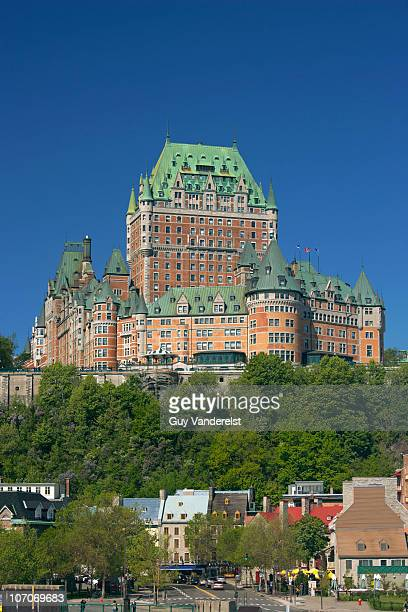 chateau frontenac and houses below in quebec city - chateau frontenac hotel stock pictures, royalty-free photos & images