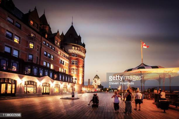 chateau frontenac at dusk - chateau frontenac hotel stock pictures, royalty-free photos & images