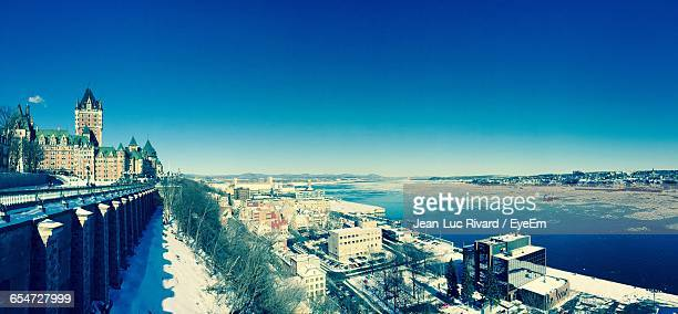 Chateau Frontenac Hotel By St Lawrence River Against Clear Blue Sky