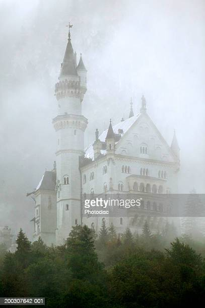 chateau in mist - castle stock pictures, royalty-free photos & images