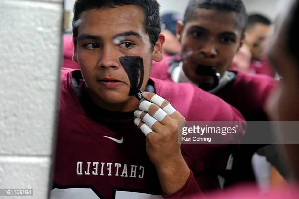 Chatfield linebacker Domanick Martinez applied eyeblack in the locker room before the game The Chatfield High School football team beat Columbine...