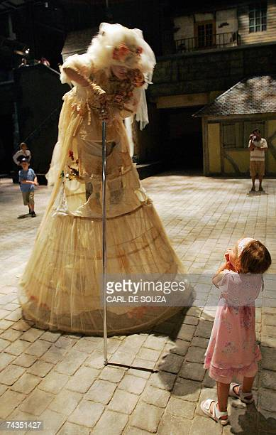 TO GO WITH AFP STORY BY Elodie Mazein Picture taken 25 May 2007 shows a young girl looking in fright at an actor dressed as a character from a...