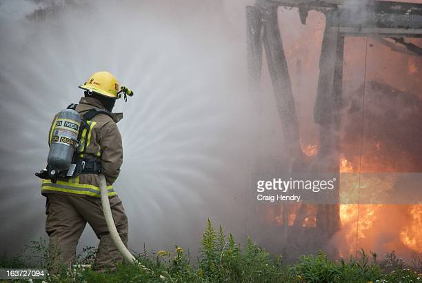 Chatham-Kent firefighter 18-25 opens up on the fire, apply the first water. <a...