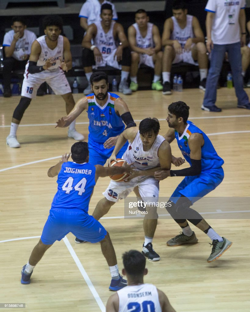 India v thailand test asian games 2018 basketball photos and chatpol chungyampin 32 of thailand vies for a ball during the basketball round stopboris Gallery