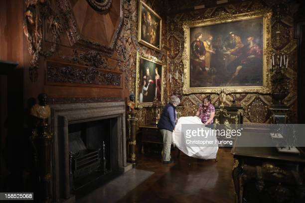 Chatsworth House conservation staff cover antique furniture in the state rooms during the process of deep cleaning at the historic stately home on...