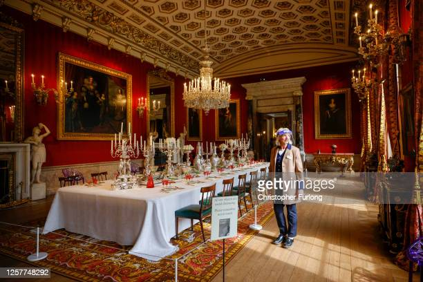 Chatsworth House guide Lizzie Ross walks through the state dining hall as the Derbyshire stately home prepares to reopen to the public after the...