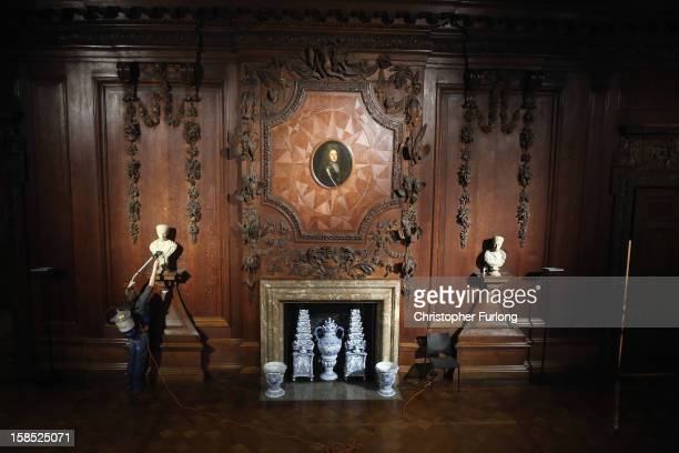 Chatsworth House house cleaning assistant Louise Randall uses a back pack vacuum cleaner to clean a fireplace during the process of deep cleaning at...