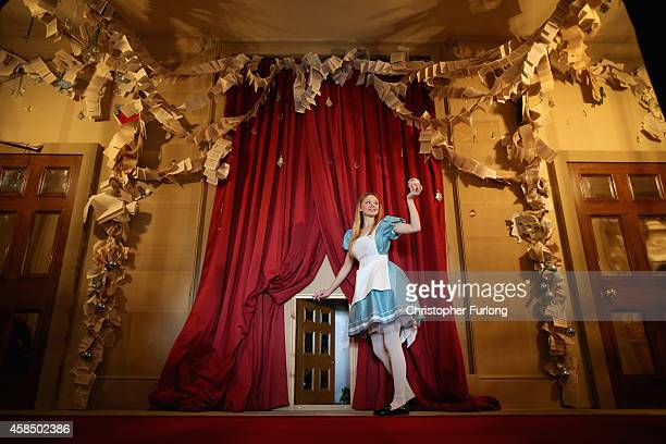 Chatsworth House staff member Ellie Cooper aged 19 poses as Alice in Wonderland as she prepares to go through the magic door in Chatsworth House as...