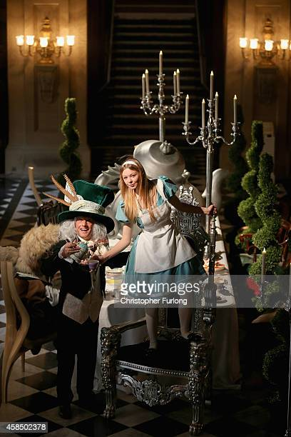 Chatsworth House staff members Ellie Cooper, aged 19, and Tim Greaves, pose as Alice in Wonderland and the Mad Hatter as they recreate the Mad...