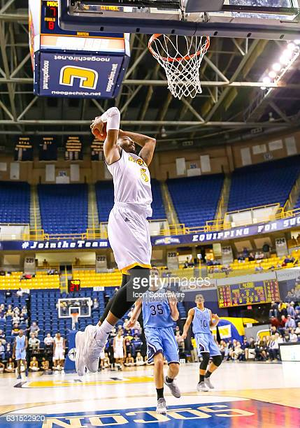 Chattanooga Mocs forward Justin Tuoyo gets the slam dunk off a fast break during the second half of the NCAA basketball game between The Citadel...