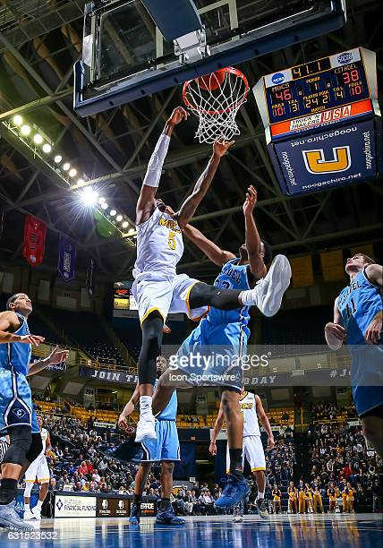 Chattanooga Mocs forward Justin Tuoyo scores with a slam dunk during the first half of the NCAA basketball game between The Citadel Bulldogs and the...