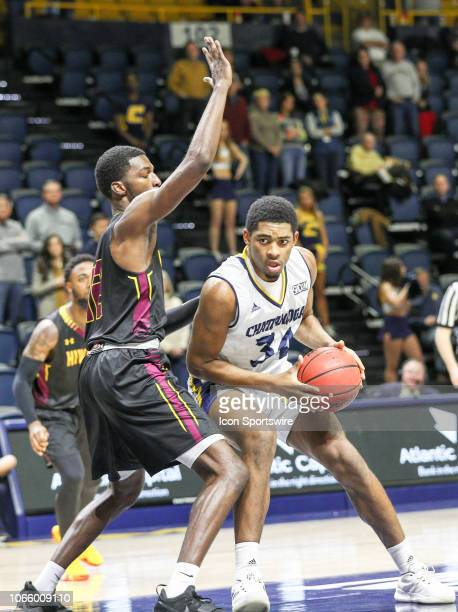 Chattanooga Mocs forward Kevin Easley handles the ball during the college basketball game between the Hiwassee Tigers and the Chattanooga Mocs on Nov...
