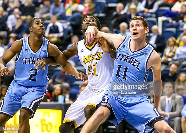 Chattanooga Mocs forward Makinde London and Citadel Bulldogs center Tom Koopman fights for position during the first half of the NCAA basketball game...