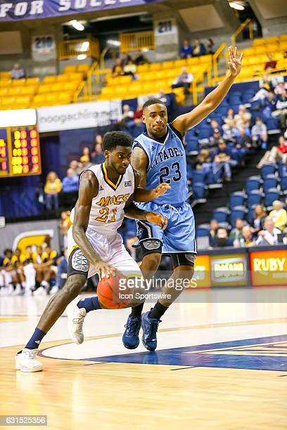 Chattanooga Mocs forward Makinde London drives to the basket during the first half of the NCAA basketball game between The Citadel Bulldogs and the...