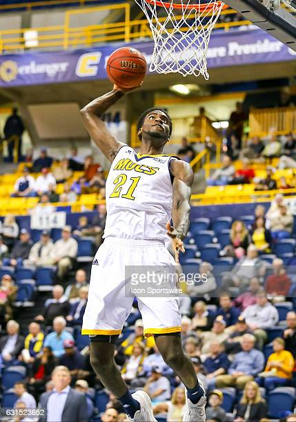 Chattanooga Mocs forward Makinde London goes in for the slam dunk during the first half of the NCAA basketball game between The Citadel Bulldogs and...