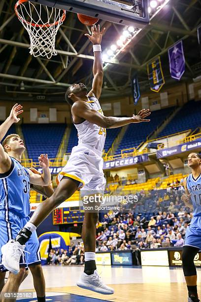 Chattanooga Mocs guard Casey Jones scores with a reverse lay up during the second half of the NCAA basketball game between The Citadel Bulldogs and...