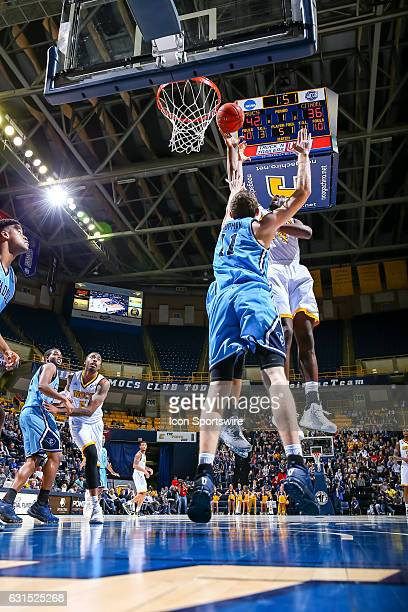 Chattanooga Mocs guard Casey Jones shoots the ball during the first half of the NCAA basketball game between The Citadel Bulldogs and the UT...