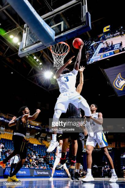 Chattanooga Mocs guard David JeanBaptiste goes up for the slam dunk during the college basketball game between the Hiwassee Tigers and the...