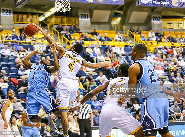 Chattanooga Mocs guard Johnathan Burroughs-Cook blocks a shot by Citadel Bulldogs guard Frankie Johnson during the second half of the NCAA basketball...