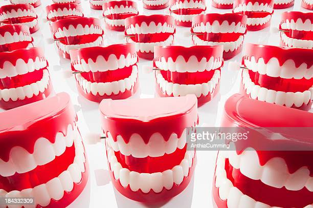 Chattering red and white plastic teeth facing camera