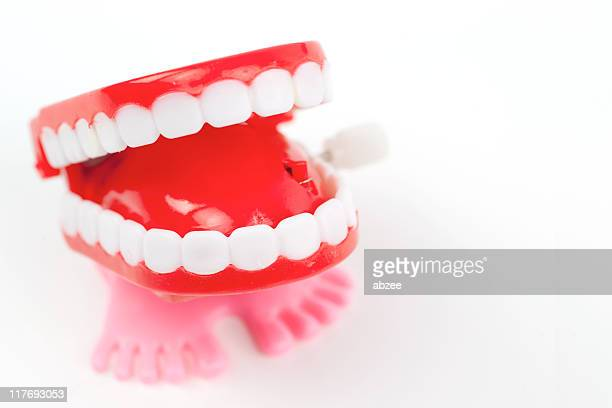 chattering teeth - wind up toy stock photos and pictures