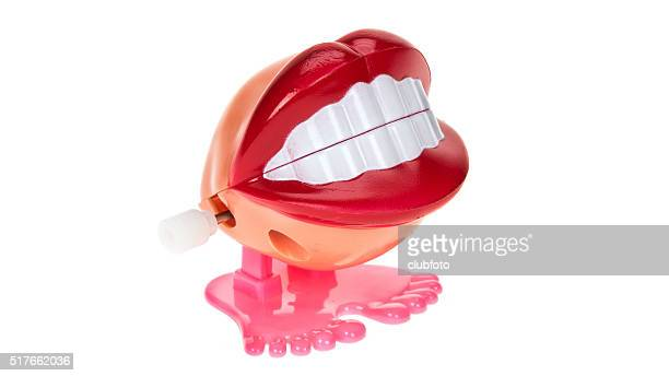 chattering teeth with big lips - big lips stock photos and pictures