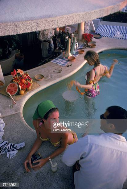 Chatting at the bar in the swimming pool at the Villa Vera racquet club in Acapulco Mexico 1968