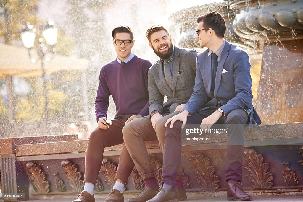 Chatting at the fountain : Stock Photo