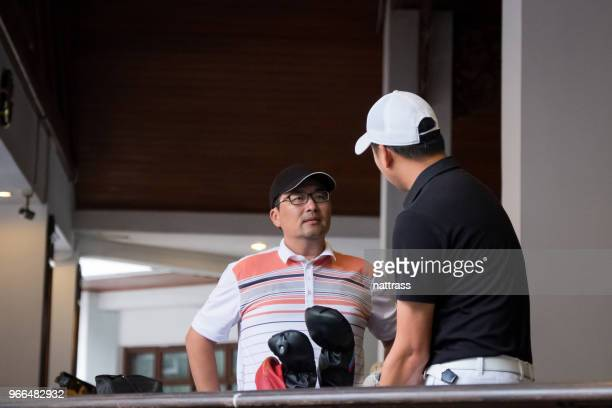 chatting before the game of golf - country club stock pictures, royalty-free photos & images