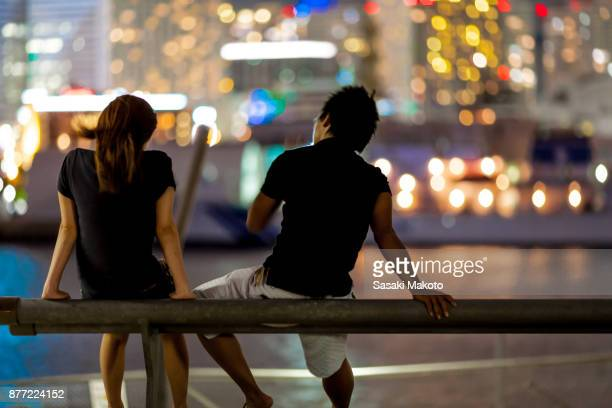 chatting in front of city lights
