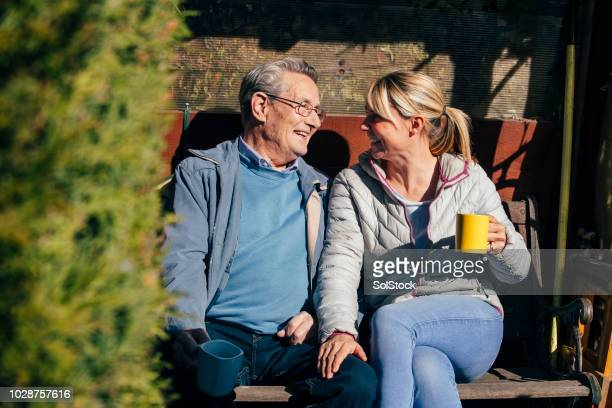 chatting over a cup of tea - vanguardians stock pictures, royalty-free photos & images