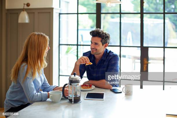 chatting together over breakfast - heterosexual couple stock pictures, royalty-free photos & images