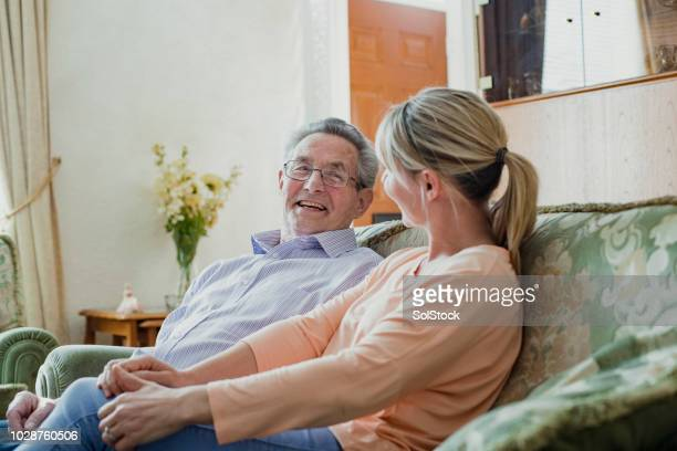 chatting with his carer - caregiver stock pictures, royalty-free photos & images