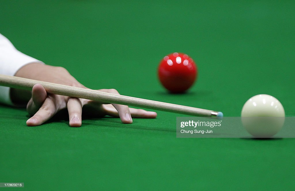 Chau Hom Man of Hong Kong plays a shot against Vafaei Ayouri Hossein of Iran during the Men's Snooker Round of 16 matches at Songdo Convensia during day seven of the 4th Asian Indoor & Martial Arts Games on July 5, 2013 in Incheon, South Korea.