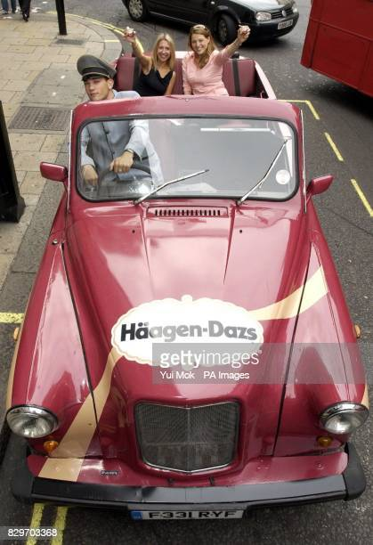 Chauffeur Daniel Bleaney with Julia Baptista and Rebecca Hurwitz during the launch of the UK's first ever convertible cab unveiled by Haagen Dazs ice...