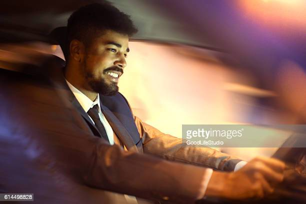 chauffeur driving car - chauffeur stock photos and pictures