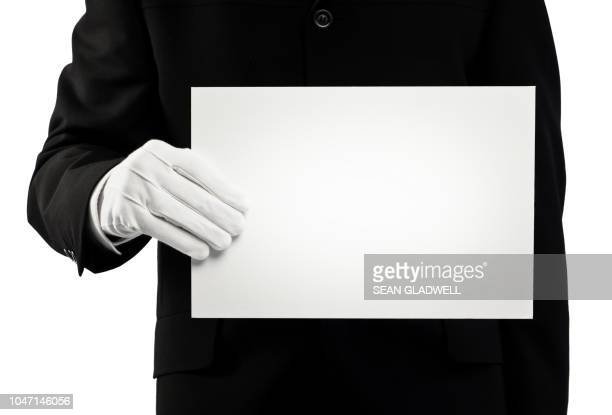 chauffeur holding blank card - white glove stock pictures, royalty-free photos & images