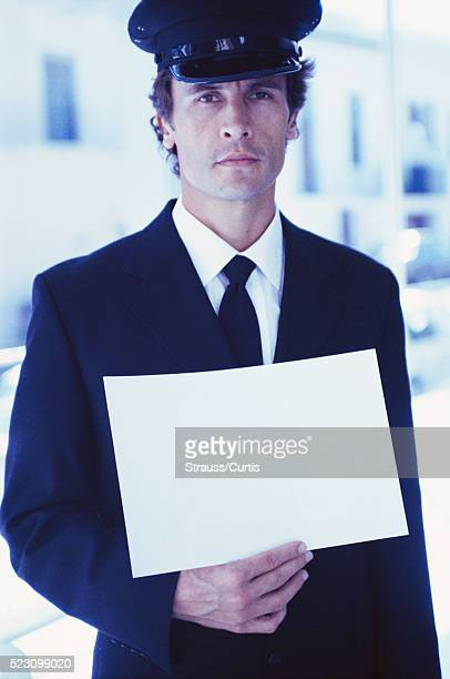Chauffeur Holding Sign